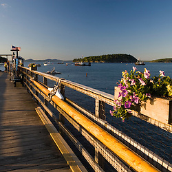 A pier in Bar Harbor, Maine.  Frenchman Bay and the Porcupine Islands are in the distance.
