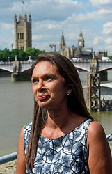 © Licensed to London News Pictures. 01/06/2017. London, UK. Pro-EU campaigner GINA MILLER (pictured) and Lib Dem candidate for Vauxhall GEORGE TURNER (not pictured) in a static boat on the River Thames, in front of the Houses of Parliament. Mrs Miller and Lib Dem candidate George Turner are recreating a stunt by former UKIP leader Nigel Farage during the EU referendum campaign, to campaign for tactical voting ahead of the General Election on June 8. Photo credit: Ben Cawthra/LNP