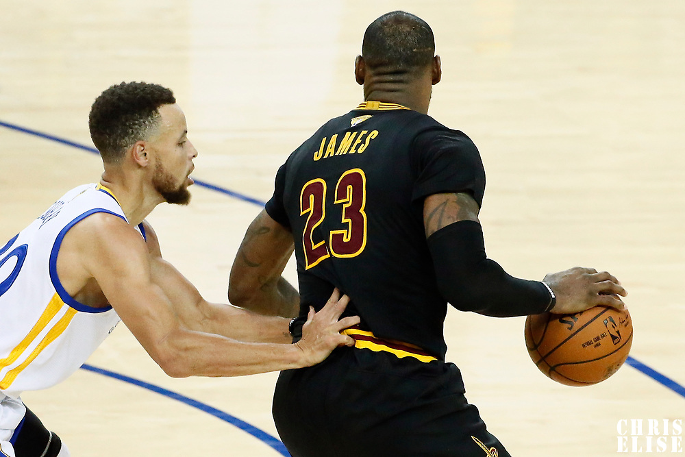 12 June 2017: Golden State Warriors guard Stephen Curry (30) defends on Cleveland Cavaliers forward LeBron James (23) during the Golden State Warriors 129-120 victory over the Cleveland Cavaliers, in game 5 of the 2017 NBA Finals, at the Oracle Arena, Oakland, California, USA.
