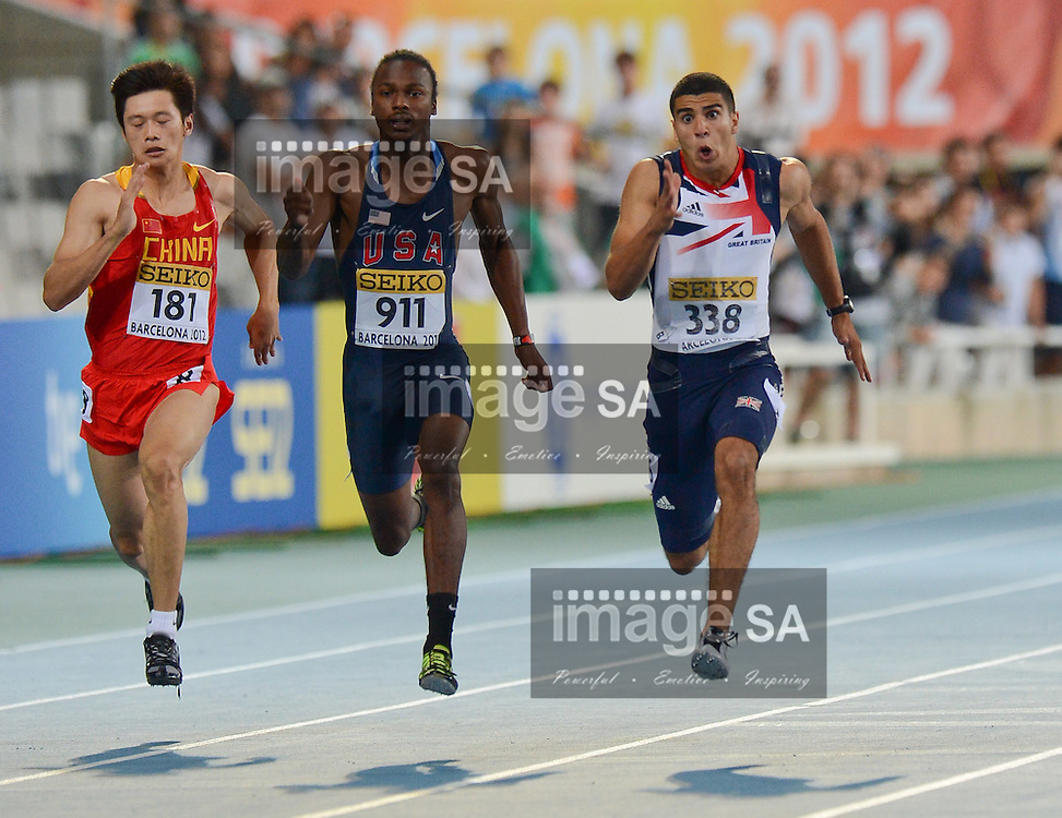 BARCELONA, Spain: Wednesday 11 July 2012, Zhenye Xie (China), Aaron Ernest (USA) and Adam Gemili (Great Britain) in the mens 100m final during the afternoon session of day 2 of the IAAF World Junior Championships at the Estadi Olimpic de Montjuic..Photo by Roger Sedres/ImageSA