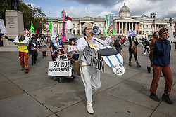 Activists from HS2 Rebellion, an umbrella campaign group comprising longstanding campaigners against the HS2 high-speed rail link as well as Extinction Rebellion activists, march through Trafalgar Square with the handmade Boris the Bank Engine to a protest rally in Parliament Square on 4 September 2020 in London, United Kingdom. The rally, and a later protest action at the Department of Transport during which activists glued themselves to the doors and pavement outside and sprayed fake blood around the entrance, coincided with an announcement by HS2 Ltd that construction of the controversial £106bn high-speed rail link will now commence.