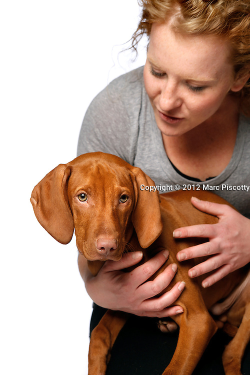 SHOT 12/12/12 4:40:21 PM - Photos of Freckles, a 17 week old male Vizsla, and his owner Lynn Sywyj of Denver, Co.(Photo by Marc Piscotty / © 2012)