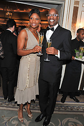 DENISE LEWIS and EDWIN MOSES at the 22nd Cartier Racing Awards held at The Dorchester, Park Lane, London on 13th November 2012.