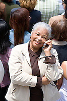 Woman using mobile phone in crowd
