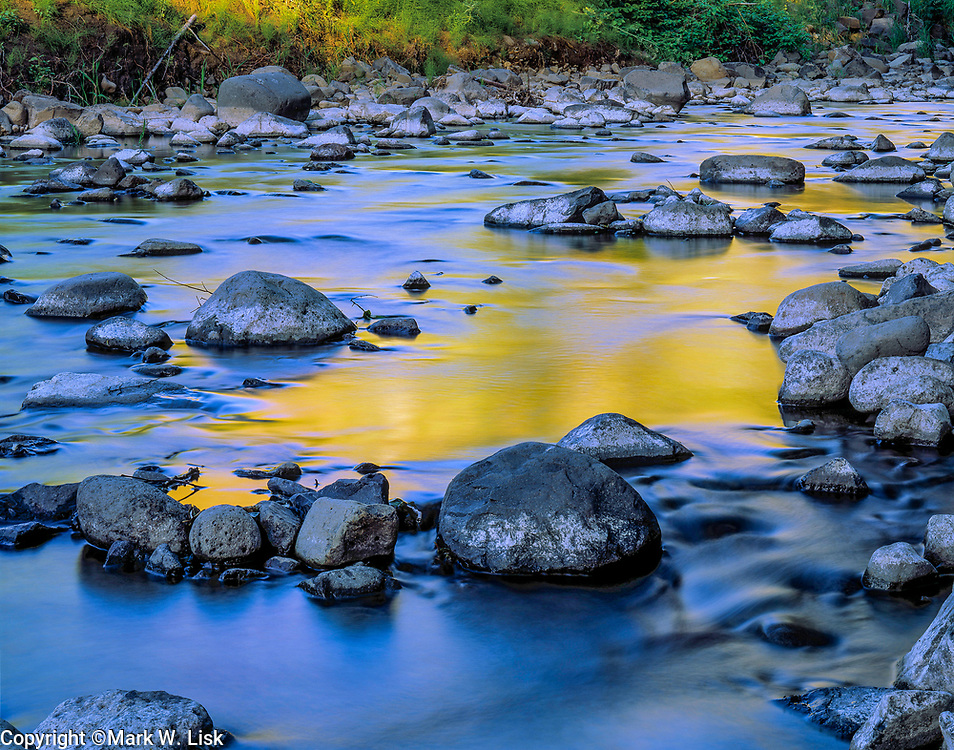 Yellow from aspen reflection illuminates the slow moving Lapwai Creek.