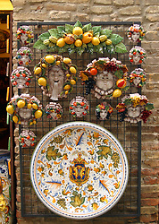 A display of ceramic and pottery souvenirs, specific location unknown.