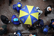an ICC Branded umbrella walking around the ground during the rain delay during the ICC Cricket World Cup 2019 match between South Africa and West Indies at the Hampshire Bowl, Southampton, United Kingdom on 10 June 2019.