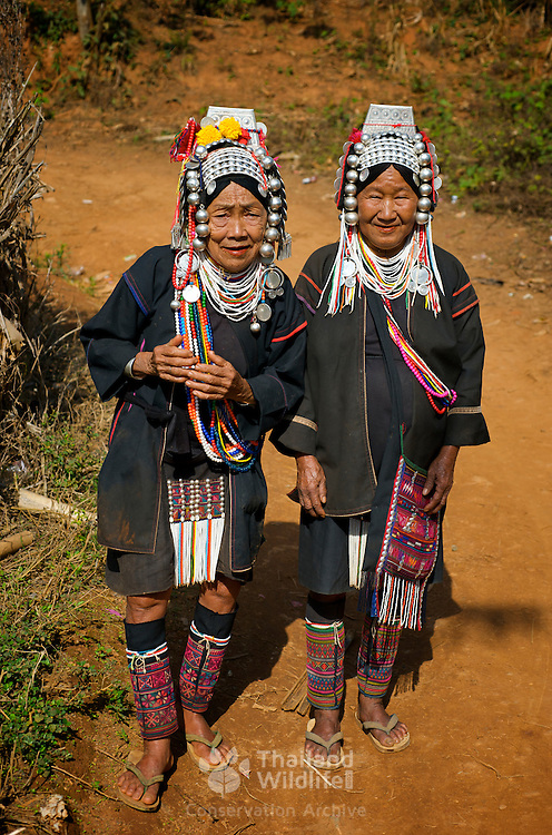 Old Akha hill tribe women in Chiang Rai province, Thailand. The Akha are the poorest of the hill tribes, well known to tourists for their extraordinary costumes and exotic appearance, the Akha originate from Tibet, and have only recently entered Thailand, the first immigrants arriving last century. They are less open to change than many other hilltribes, proudly retaining their old customs.