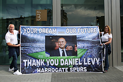 © Licensed to London News Pictures. 03/04/2019. London, UK. Phil and Sue from Harrogate with a large banner outside the new Spurs stadium as Tottenham Hotspur's play their first competitive game against Crystal Palace this evening. Photo credit: Dinendra Haria/LNP
