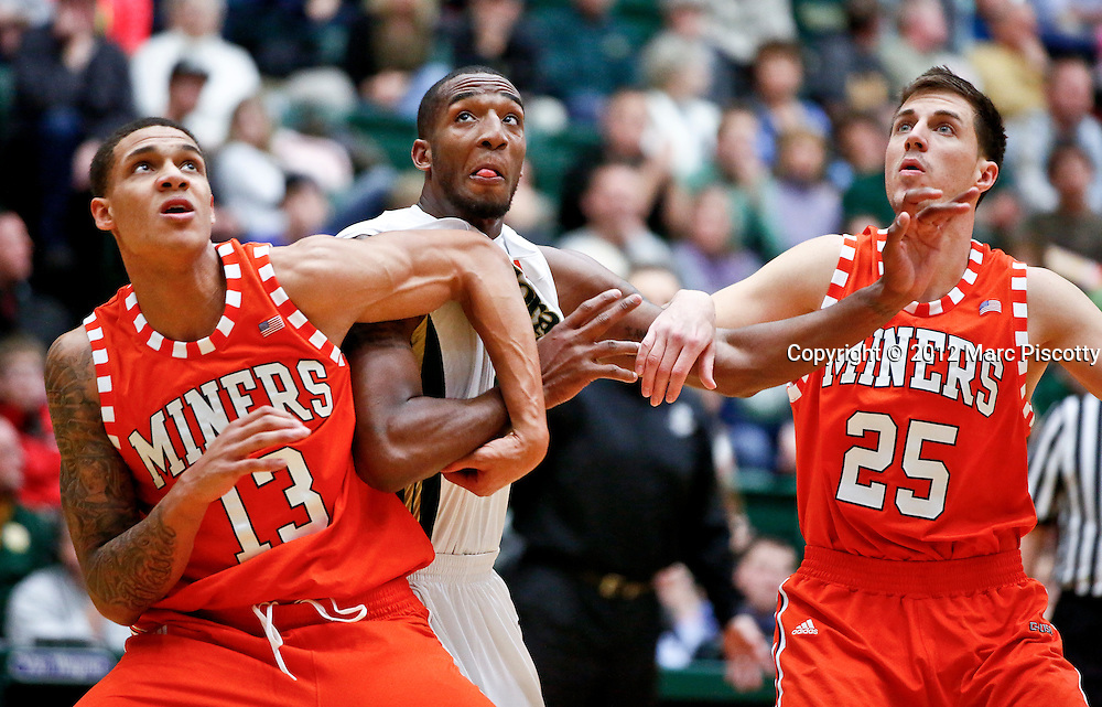 SHOT 1/3/13 9:24:46 PM - Colorado State's Greg Smith #44 battles for a rebound with UTEP's McKenzie Moore #13 and Konner Tucker #25 during their regular season basketball game at Moby Arena in Fort Collins, Co. Colorado State won the game 62-58. (Photo by Marc Piscotty / © 2012)