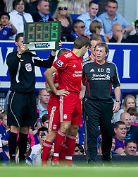 LIVERPOOL, ENGLAND - Saturday, October 1, 2011: Liverpool's manager Kenny Dalglish prepares to bring on substitute captain Steven Gerrard MBE against Everton during the Premiership match at Goodison Park. (Pic by David Rawcliffe/Propaganda)