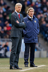 Manchester City Manager Manuel Pellegrini looks on behing Arsenal Manager Arsene Wenger - Photo mandatory by-line: Rogan Thomson/JMP - 07966 386802 - 18/01/2015 - SPORT - FOOTBALL - Manchester, England - Etihad Stadium - Manchester City v Arsenal - Barclays Premier League.