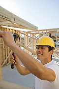 Construction worker hammering on construction site