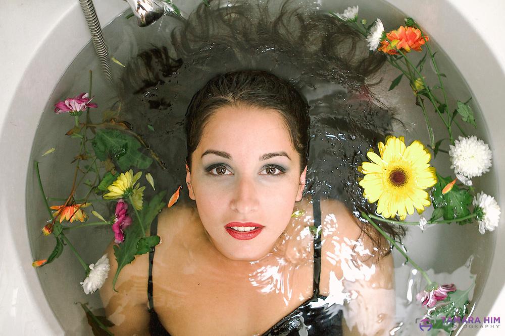 A  portrait taken in  {Dublin} Cristina taking a flower bath. ©Tamara Him.
