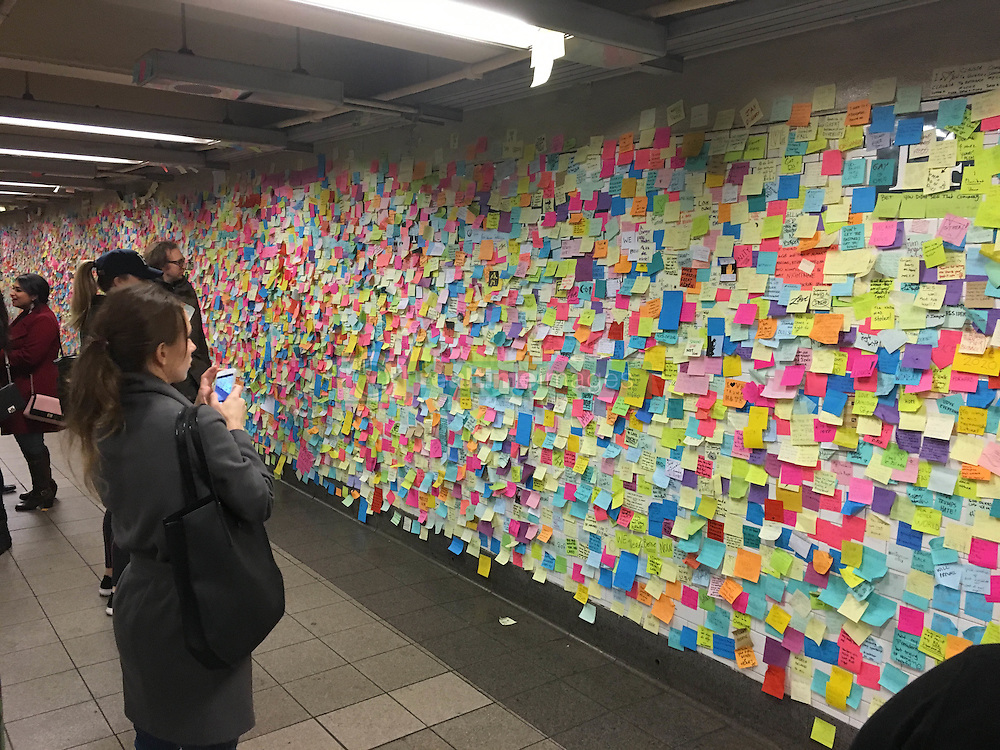 Anti-Trump Stickies (Post Its) continue to spread out further along the walls and pillars of The Union Square Station in New York City, 24th November 2016