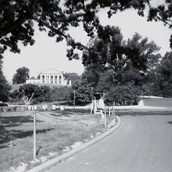 Summer 1970:  Custis-Lee Mansion is seen from across the Arlington cemetery property at the Arlington National Cemetery...Image taken by a pre-teen boy during the year listed in caption,  scanned and adjusted in PhotoShop.  Image was shot with a Kodak Hawkeye 126 Instamatic camera..