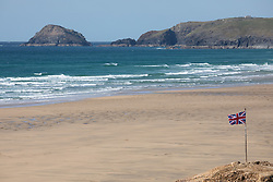 "© Licensed to London News Pictures. 11/05/2020. Perranporth, UK. Perranporth beach, on the North coast of Cornwall is nearly empty, the day after British Prime Minister Boris Johnson announced a 'road map' to lift lockdown restrictions due to Covid-19, (Coronavirus). A rise in ""staycations"" - the concept of holidaying in your home country rather than travelling abroad - is expected, with many visitors planning to visit Cornwall. However, an ongoing campaign titled ""#ComeBackLater"" is trying to persuade tourists not to visit the county until it is safe to do so. Photo credit : Tom Nicholson/LNP"