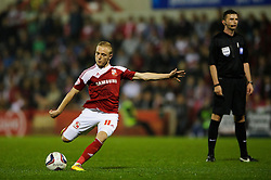Swindon Forward Alex Pritchard (ENG) strikes a free kick during the second half of the match - Photo mandatory by-line: Rogan Thomson/JMP - Tel: 07966 386802 - 24/09/2013 - SPORT - FOOTBALL - The County Ground - Swindon Town v Chelsea - Capital One Cup Round 3.