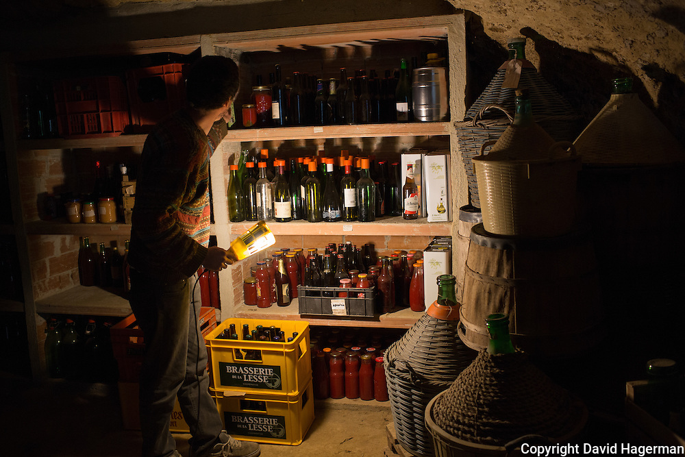 Filipo Laguzzi in the cave storage cellar where beer, sauces and preserves are kept. Birrificiao Agricole di Montcalieri