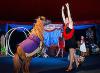 """""""Zeus"""" and Sara Greene perform in the center ring with Gigi Greene, """"Rosie"""" the dog and Haley Warren in the Granite State Circus at Weirs Beach.  (Karen Bobotas/for the Laconia Daily Sun)"""