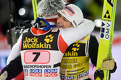 Thomas Morgenstern and Andreas Kofler of Austria celebrates winning the 58th Four Hills ski jumping tournament at the medal ceremony, on January 6, 2010 in Bischofshofen, Austria.  (Photo by Vid Ponikvar / Sportida)
