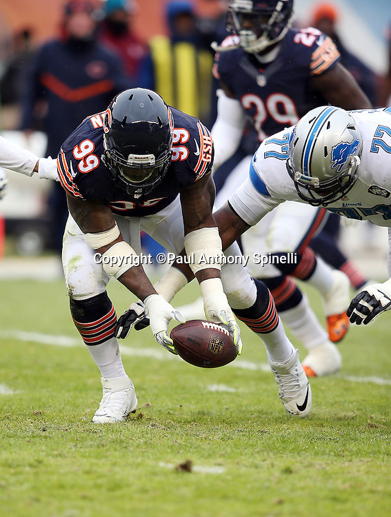 Chicago Bears linebacker Lamarr Houston (99) recovers an apparent fumble, later ruled not a fumble, as he grabs the ball before Detroit Lions tackle Cornelius Lucas (77) gets to the ball during the NFL week 17 regular season football game against the Detroit Lions on Sunday, Jan. 3, 2016 in Chicago. The Lions won the game 24-20. (©Paul Anthony Spinelli)