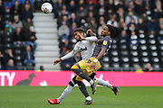 Derby County defender Jayden Bogle and Sheffield Wednesday midfielder Rolando Aarons challenge for the ball during the EFL Sky Bet Championship match between Derby County and Sheffield Wednesday at the Pride Park, Derby, England on 9 March 2019.