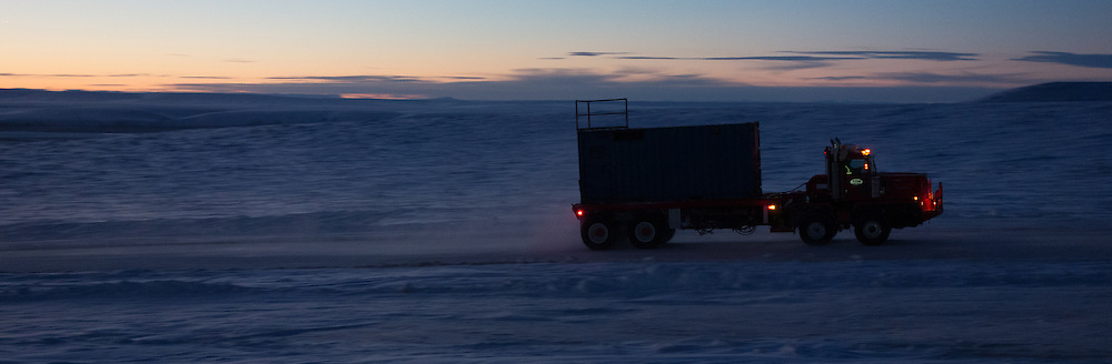 A Cruz Construction bed truck hauls a rig component to an ice pad in Umiat, Alaska, during the 2013-2014 winter season. Cruz Construction provided rig support for Linc Energy's drilling program in Umiat.