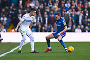 Pablo Hernandez of Leeds United (19) passes the ball between the legs of Craig Noone of Bolton Wanderers (12) during the EFL Sky Bet Championship match between Leeds United and Bolton Wanderers at Elland Road, Leeds, England on 23 February 2019.