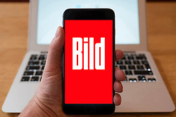 Using iPhone smartphone to display logo of Bild German tabloid magazine