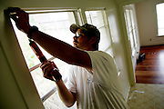 PALCO Painter Brad Jones installs new blinds in a Scotia, CA home on Wednesday, June 28, 2006. Every home in Scotia is thoroughly cleaned, repaired, and painted by a team of painters, carpenters, and plumbers before a new tenant moves in. The town of Scotia in Northern California is a company town owned by the Pacific Lumber Company (PALCO), but that will change as the company will begin to sell the town. (Photo by Max Whittaker for The New York Times)<br />