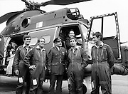 Mr James Tully TD, Minister for Defence, inspecting the latest addition to the Air Corps fleet – a French-built SA 330J 'Puma' twin-engined helicopter – at Casement Aerodrome, Baldonnell, County Dublin. Centre: Brig-General William Glenn, GOC Air Corps. Also Comdt. Hugh O'Donnell (left) and Comdt. Ken Byrne.<br />