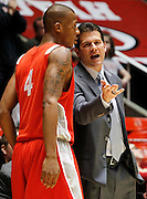 New Mexico head coach Steve Alford talks with forward Chad Adams (4) during the second half of an NCAA college basketball game, Wednesday, Jan. 19, 2011, in Salt Lake City, Utah. Utah defeated New Mexico 82-72. (AP Photo/Colin E Braley)