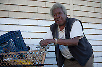Portrait of homeless African American man with shopping cart
