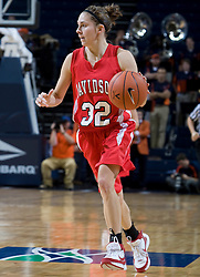 Davidson guard Kelly Gassie (32) dribbles the ball up court.  The Virginia Cavaliers women's basketball team defeated the Davidson Wildcats 83-68 at the John Paul Jones Arena in Charlottesville, VA on December 20, 2007.
