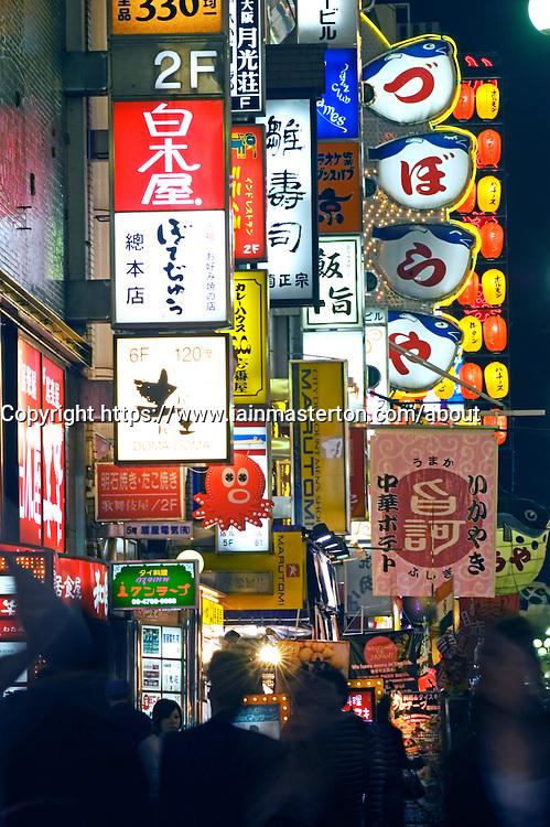 Bright advertising signs at night in Dotonburi nightlife district of Osaka in Japan