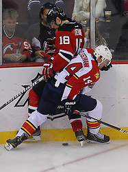 Feb 11; Newark, NJ, USA; Florida Panthers left wing Tomas Fleischmann (14) and New Jersey Devils right wing Steve Bernier (18) battle for the loose puck during the third period at the Prudential Center. The Panthers defeated the Devils 3-1.