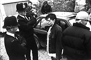 A46 woman conversing with police officers, Solsbury Hill, Somerset, UK, 1994.