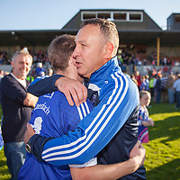 Members of the Cratloe team and management celebrate after their final win