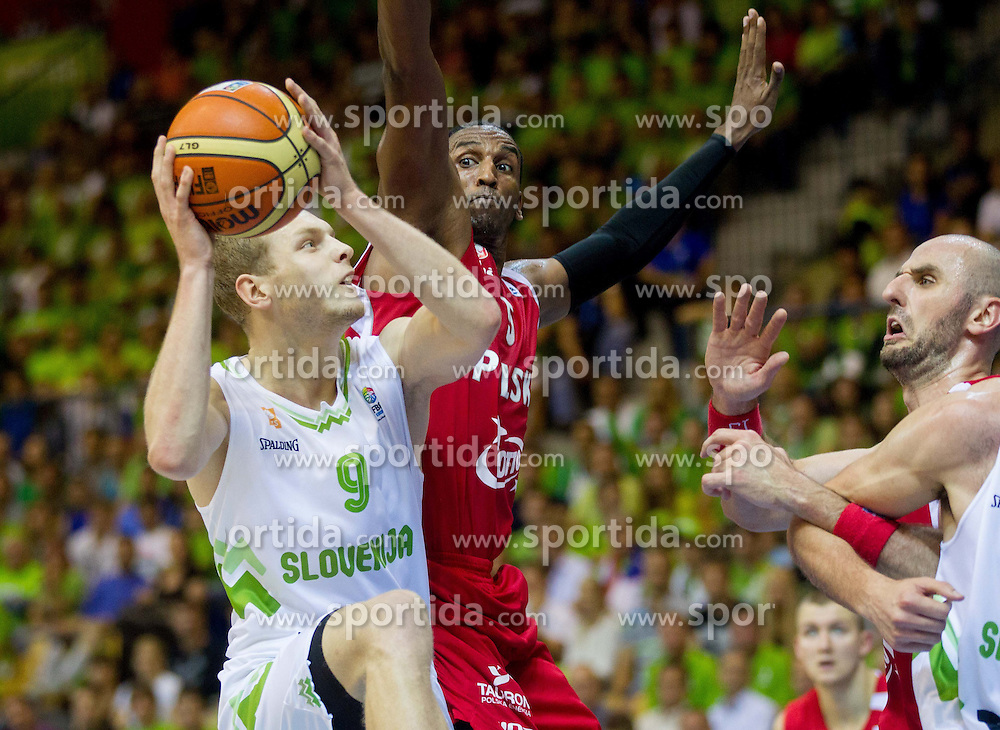 Jaka Blazic of Slovenia vs Thomas Kelati #5 of Poland during basketball match between National teams of Slovenia and Poland in Round 1 at Day 6 of Eurobasket 2013 on September 9, 2013 in Arena Zlatorog, Celje, Slovenia. (Photo by Vid Ponikvar / Sportida.com)