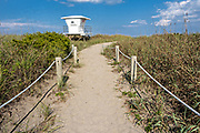 Sandy beach walkway and lifeguard station at Avalon State Park in Fort Pierce, Florida.