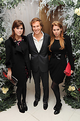 Left to right, PRINCESS EUGENIE OF YORK, DAVE CLARK and PRINCESS BEATRICE OF YORK at the launch of the English National Ballet's Christmas season 2009 held at the St.Martin;s Lane Hotel, London on 15th December 2009.