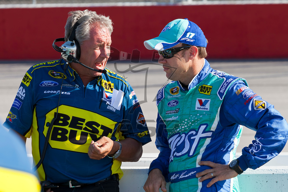 DARLINGTON, SC - MAY 11, 2012:  Crew Chief, Jimmy Fenning, and Matt Kenseth (17) talk during qualifying for the Bojangles Southern 500 at the Darlington Raceway in Darlington, SC.
