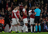 Football - 2018 / 2019 UEFA Europa League - Round of Sixteen, Second Leg: Arsenal (1) vs. Rennes (3)<br /> <br /> Alexandre Lacazette (Arsenal FC) speaks to the referee after Clement Grenier (Rennes FC) has dived to try and get him sent off at The Emirates.<br /> <br /> COLORSPORT/DANIEL BEARHAM