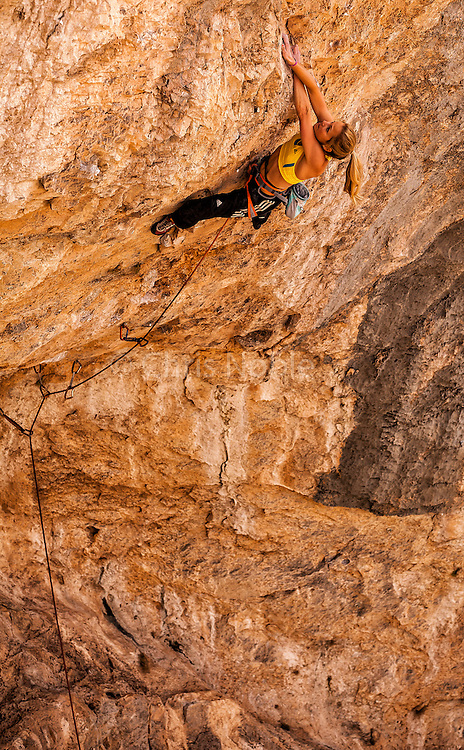 "Sasha DiGiulian climbing a route named ""Indulgence"" rated13b at ""The Wailing Wall,"" near St. George Utah."