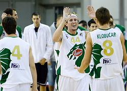 Matt Walsh and Jaka Klobucar of Olimpija celebrate at Superpokal basketball match between KK Union Olimpija and Elektra Esotech, on September 27, 2009, in Arena Tivoli, Ljubljana, Slovenia. Olimpija won 95:62.  (Photo by Vid Ponikvar / Sportida)