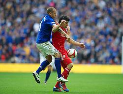 LONDON, ENGLAND - Saturday, April 14, 2012: Liverpool's Luis Alberto Suarez Diaz and Everton's John Heitinga during the FA Cup Semi-Final match at Wembley. (Pic by David Rawcliffe/Propaganda)