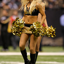 2009 December 19:  New Orleans Saints Saintsations cheerleaders perform during a 24-17 win by the Dallas Cowboys over the New Orleans Saints at the Louisiana Superdome in New Orleans, Louisiana.