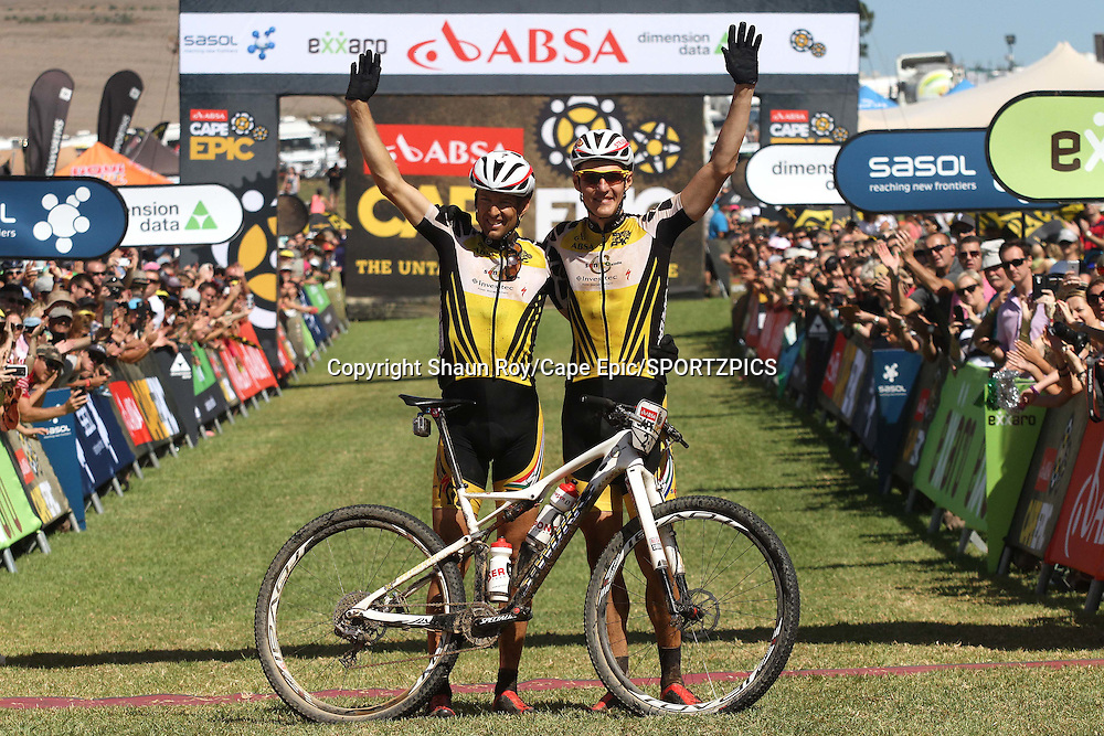 Christoph Sauser of Investec-Songo-Specialized and Jaroslav Kulhavy of Investec-Songo-Specialized celebrate winning the 2015 Absa Cape Epic during the final stage (stage 7) of the 2015 Absa Cape Epic Mountain Bike stage race from the Cape Peninsula University of Technology in Wellington to Meerendal Wine Estate in Durbanville, South Africa on the 22 March 2015<br /> <br /> Photo by Shaun Roy/Cape Epic/SPORTZPICS<br /> <br /> PLEASE ENSURE THE APPROPRIATE CREDIT IS GIVEN TO THE PHOTOGRAPHER AND SPORTZPICS ALONG WITH THE ABSA CAPE EPIC
