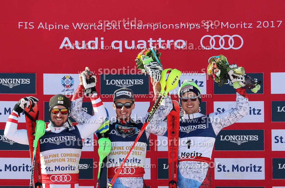 13.02.2017, St. Moritz, SUI, FIS Weltmeisterschaften Ski Alpin, St. Moritz 2017, alpine Kombination, Herren, Flower Zeremonie, im Bild v.l. Marcel Hirscher (AUT, Herren Alpine Kombination Silbermedaille), Luca Aerni (SUI, Herren Alpine Kombination Weltmeister und Goldmedaille), Mauro Caviezel (SUI, Herren Alpine Kombination Bronzemedaille) // f.l. men&rsquo;s Alpine Combined Silver medalist Marcel Hirscher of Austria, men&rsquo;s Alpine Combined world Champion and Gold medalist Luca Aerni of Switzerland, men&rsquo;s Alpine Combined Bronze medalist Mauro Caviezel of Switzerland during the Flowers ceremony for the men's Alpine combination of the FIS Ski World Championships 2017. St. Moritz, Switzerland on 2017/02/13. EXPA Pictures &copy; 2017, PhotoCredit: EXPA/ Sammy Minkoff<br /> <br /> *****ATTENTION - OUT of GER*****